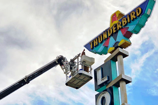 Neon Thunderbird sign undergoing sign maintenance